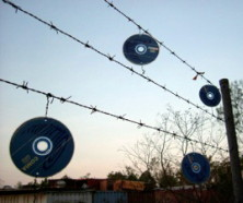 fence with CDs